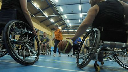 Police officers from Mildenhall and Brandon join the Bury Bombers wheelchair basketball team at Culf
