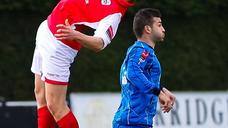 Needham Market's Keiran Morphew (red) with his old and traditional black boots on!