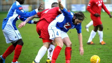 Tough-tackling central midfielder Luke Hammond (blue number four) in action during his Leiston days.