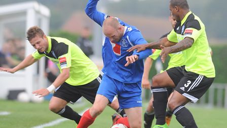 Michael Brothers (blue) has been let go by Leiston boss Steve Ball