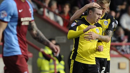 Freddie Sears celebrates scoring the equaliser for Colchester at Scunthorpe