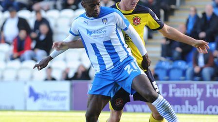 Gavin Massey, in action against Fleetwood last weekend, has signed a new deal at Colchester United.