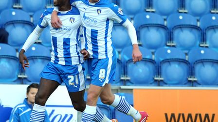 Gavin Massey (left) celebrates his first goal with Alex Gilbey