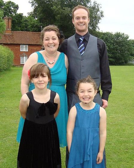 Louise Burke, partner Richard, and daughters Lily, left, and Olive
