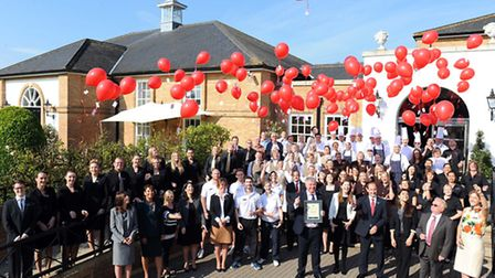 Bedford Lodge chief executive Noel Byrne and the hotel's staff celebrating the award for four AA red
