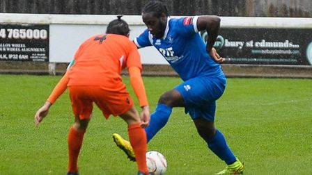 Bury Town's new exciting striker Joe Benjamin attempts a stepover