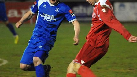Gareth Heath (red) was on target for Leiston against Bury Town on Tuesday evening
