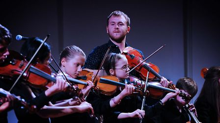Sam Sweeney of The Full English Quartet with students, Ipswich School Festival of Music 2014. Photo: