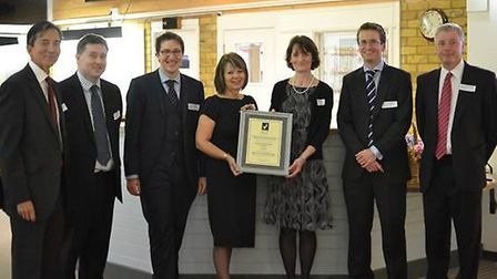 The partners and practice manager of Woolpit Health Centre with the award certificate. From L-R: Dr
