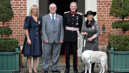 Three people from Suffolk received British Empire Medals at a ceremony at Helmingham Hall, presented