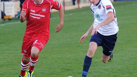 Needham Market v Witham Town - FA Cup action. Needham in red. Needham's Luke Ingram and Witham's Tom