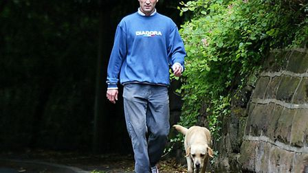Roy Keane walks his dog outside his home in Hale Barnes, Cheshire after returning from the 2002 Worl