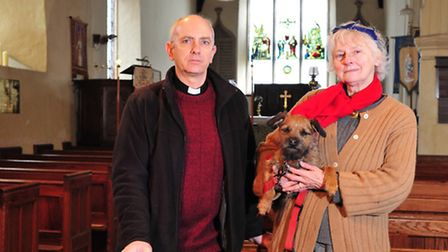 Rev Ian Byrne and church warden Gillian Evans at Mettingham Church after a previous theft.