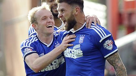 Ipswich Town duo Daryl Murphy and Jonny Williams celebrate the former's second goal at Nottingham Fo