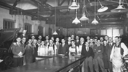 Composing room staff at the EADT in Carr Street in January 1934. (Note the mixture of gas and electr