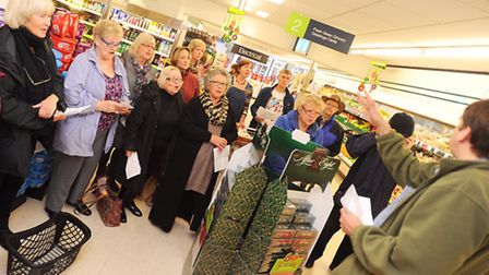 The Hadleigh Community Choir performing surprise pop-up songs in Hadleigh to raise money for Child