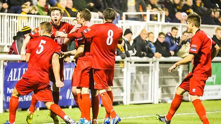 Kris Newby celebrates with his team mates after scoring his and AFC Sudbury's second goal in the eig