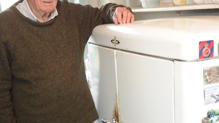 Michael Watson and his 1948 Frigidaire refrigerator, which his father bought from America after the