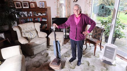 Ann Sadler with an upright Hoover vacuum cleaner her mother bought second hand in 1961 and which is
