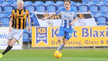 Elliott Hewitt, right, in action during his last U's appearance against Port Vale. He has returned t