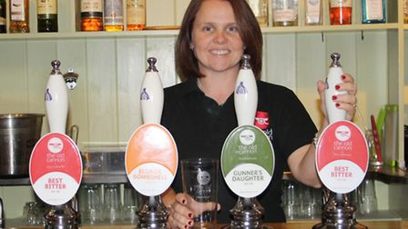 Hannah Clark behind the bar at the Old Cannon in Bury St Edmunds.