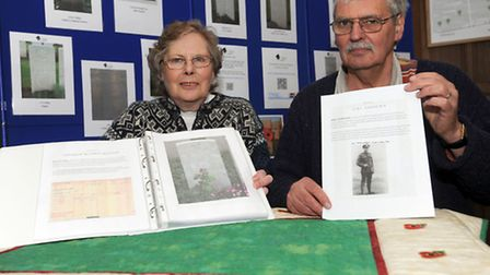Tim and Sheila Holmes are pictured at St John the Baptist Church in Campsea Ashe with the book that