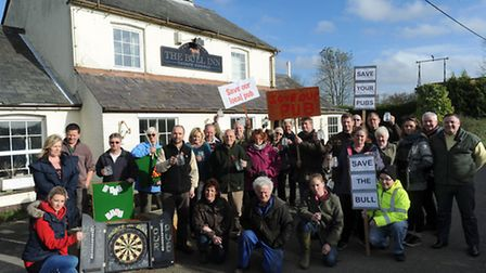Locals outside the former pub who are calling for it to re-open.