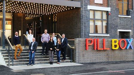 Members of the Crafted team outside the Ipswich digital agency's newLondon office, at the Pill Box