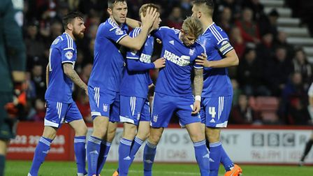 Teddy Bishop is congratulated after scoring at Bournemouth