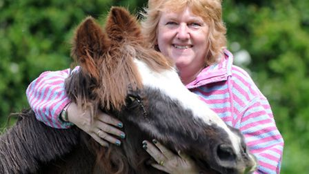 Diane Cooper with one of Heartbeat Home for Horses' residents