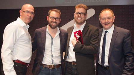 From left, Tom Gillman, Brad Warwick and Ian Miller receive their trophy at the UK Search Awards fro