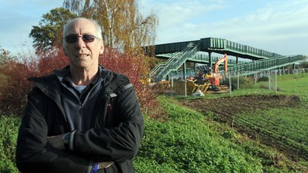 Nigel Rhodes is pictured at the new railway bridge in Heath Road, Thurston.