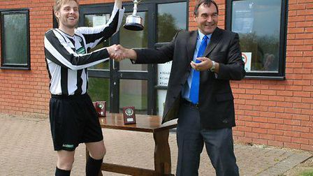Ali Mayhew receives the trophy from SIL chairman Keith Norton back in 2010