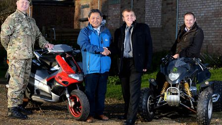 Bikes seized on Army ranges handed back to the community. (L to R) Sergeant Peter Chamberlain, trai