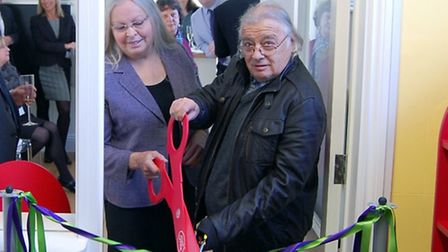 Ann Readman and Bob Kerr cutting the ribbon at the official opening