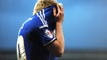 Jonny Williams limps off the field in agony during Saturday's 1-0 home win over Watford. Photo: Sara