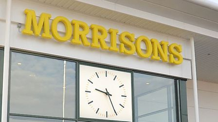 Morrisons has reported signs of progress in its efforts to halt a decline in sales.