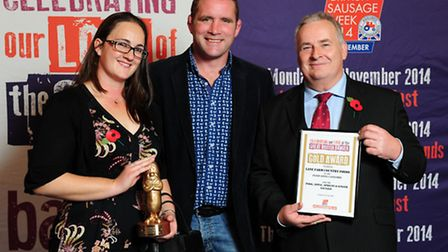 Ian Whitehead and his daughter Rebecca accepting the award for Best Innovative Sausage from rugby le