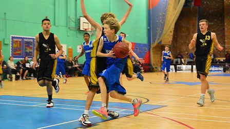 Joe Hindley shows determination as he drives to the hoop for Ipswich U14 boys. Pic: Pavel Kricka