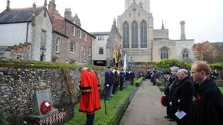 The Remembrance service in the Rose Garden in the Abbey Gardens in Bury.