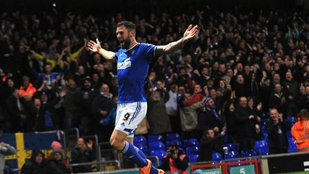 Daryl Murphy celebrates his second goal against Wolves