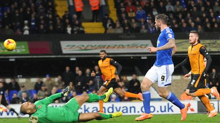 Daryl Murphy dinks the ball over Carl Ikeme to make it 2-1 to Ipswich Town. Photo: Sarah Lucy Brown