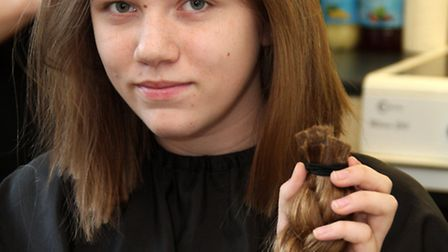 Saxmundham teenager Abigail Howes has around 11 inches of her hair cut off to donate to the Little P