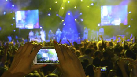 Camera phones are ruining the atmosphere at concerts as well obscuring our view of the stage.