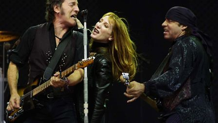 Bruce Springsteen, left, with his wife Patti Scialfa, center, and Steve van Zandt, right, is making