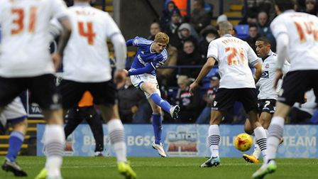 Teddy Bishop fires a shot on target through a forest of Bolton defenders