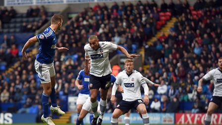 Tommy Smith heads towards goal at the near post during the first half at Bolton