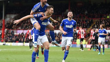 Tommy Smith celebrates after scoring Ipswich's fourth at Brentford