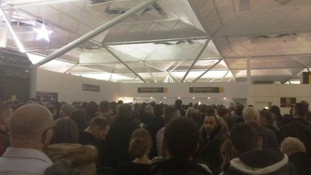 The queues at Stansted airpor after a power failure. Credit: Jennie Thomas