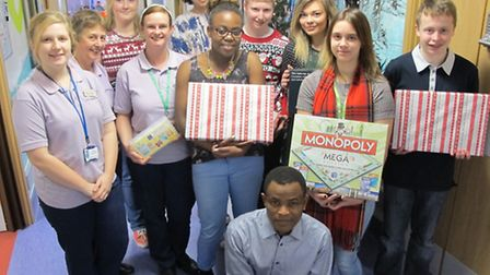 ( front) Edward Nkwelle, Essex County Council youth worker, (third from right) Christabelle Woods, y